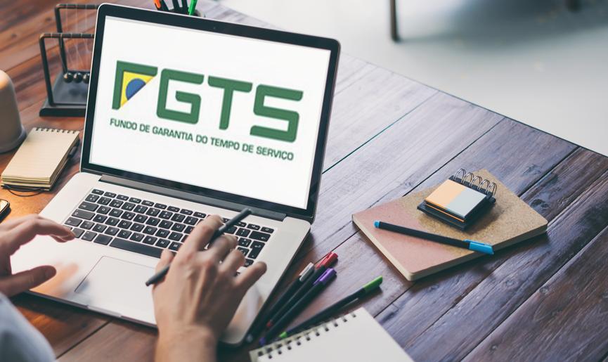 Imagem de notebook com o logo do FGTS para empregada doméstica na tela